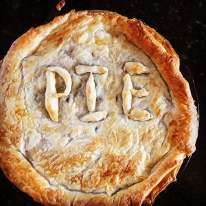 Pie with P-I-E spelt on top in pastry