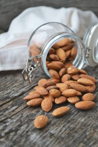 almonds spilling out of open glass jar