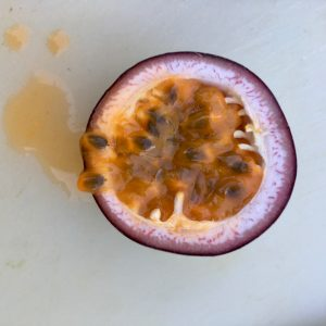 half a passionfruit on a board