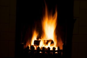 wood burning in fireplace cosy winter