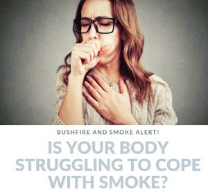 Woman with brown hair and glasses with pained look on face coughing underneath text reads bushfire and smoke alert is your body struggling to cope with smoke