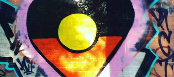 heart shaped Aboriginal flag street art in sun during lockdown in Sydney innerwest